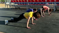 Group of girls are practicing the plank pose, video