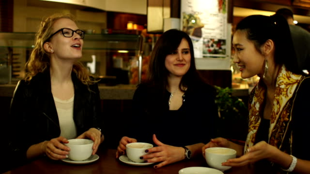 Group of girls chatting in coffee shop video