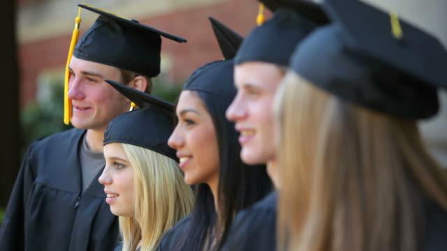 Group of graduates, rack focus video