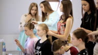 Group of handsome girls prepares for photo session in make-up room video