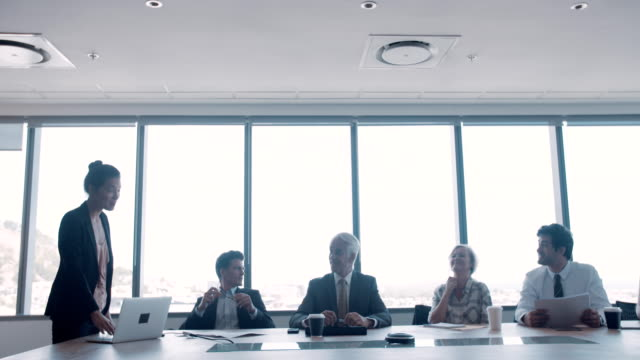 Group of happy coworkers meeting in conference room video