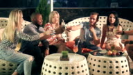 Group of happy friends enjoying an evening drink video