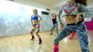 Group of happy women doing 'Zumba' dance fitness in class video
