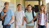 Group Of High School Students Walking Along Hallway video