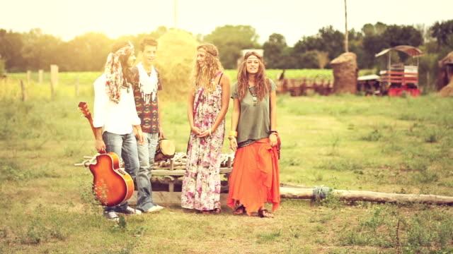 Group of hippie friends walk away video