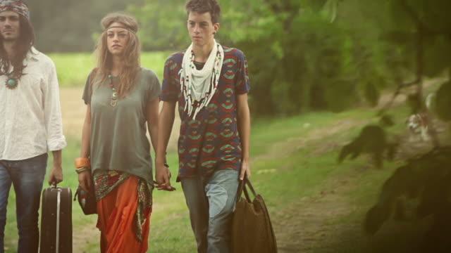 Group of hippie friends walk by video