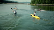 HD: Group of kayakers competing on lake video