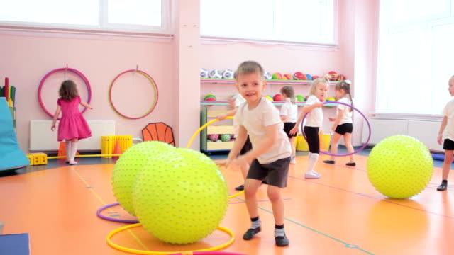 Group of kids having fun in kindergarten video
