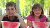 Group of kids outdoors with watermelon video