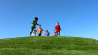 Group of kids running, slow motion video