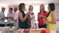 Group Of Mature Friends Enjoying Dinner Party Shot On R3D video