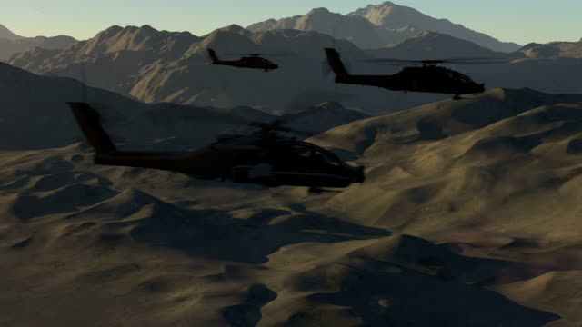 Group Of Military Helicopters Flying Over The Mountain video