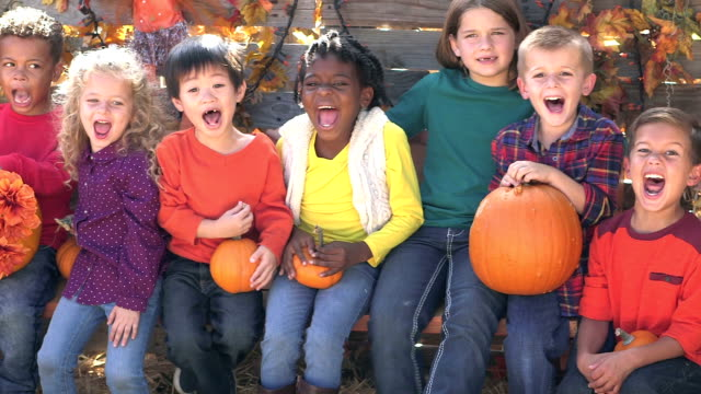 Group of multi-ethnic children at fall festival video