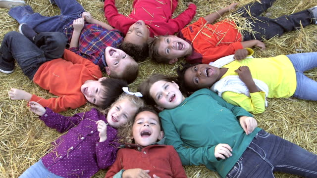 Group of multi-ethnic children at video