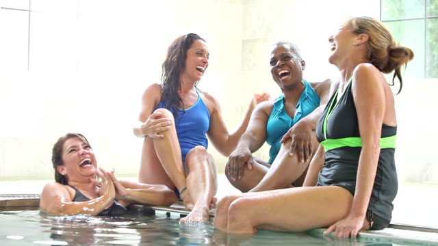 Group of multi-ethnic women talking by side of pool video