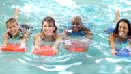 Group of multiracial  women swimming with kickboards video