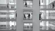 Group of office workers walking on elevated walkway video