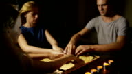 group of people at a spiritualistic. people call spirits video