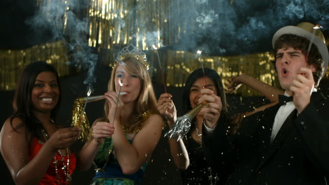 Group of people at New Year's party with sparklers video