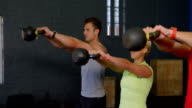 Group of people exercise with kettlebell video