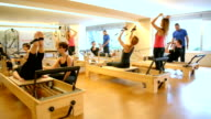 DOLLY: Group of people exercising with pilates machines video