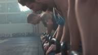 Group of people making push-ups video