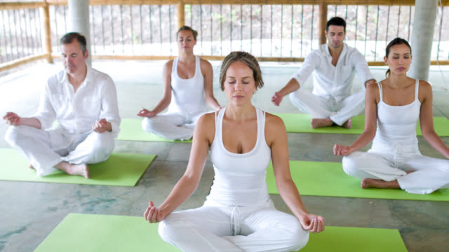 Group of people meditating video