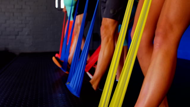 Group of people performing exercise with resistance band video