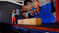 Group of people performing plyometric exercise video