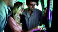 Group of people playing slots and winning. video