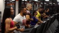 Group of people running on treadmills video