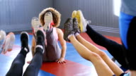 Group of People Stretching in Fitness Class video