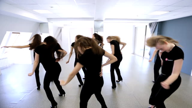 Group of pretty girls has lesson in dancing classroom video