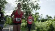 Group of runners running outside during a 5K, 10K or marathon race video