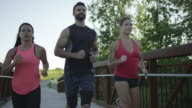 Group of runners running outside video