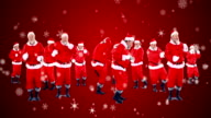 Group of santa claus dancing on a snowy landscape video