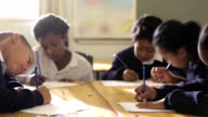 Group of school children drawing video
