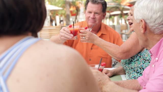 Group Of Senior Friends Enjoying Cocktails In Bar Together video