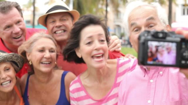 Group Of Senior Friends Taking Selfie In Park video