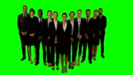 Group of smiling business executives standing video