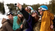 Group of snowboarders take self portrait together video