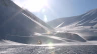 A group of snowmobiles on the background of a snowy landscape at Svalbard Norway video