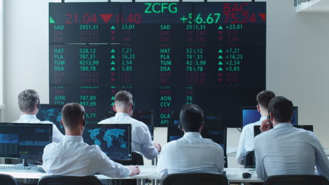 Group of Stockbrockers Actively Working at Stock Exchange video