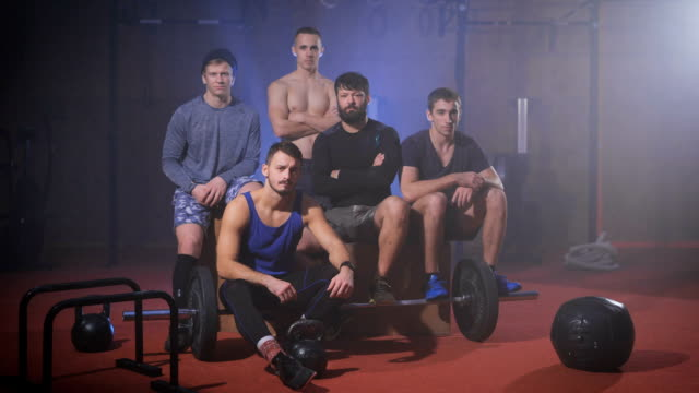 Group of strong men at the gym gives thumbs up and say yes video