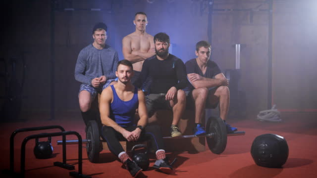 Group of strong men at the gym shaking their heads to indicate rejection video