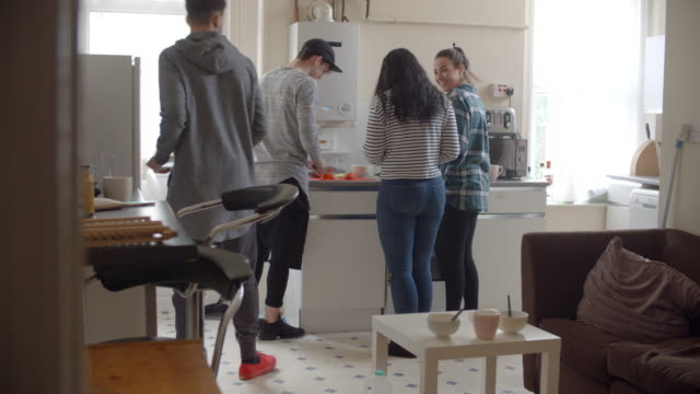 Group Of Students Cooking Meal In Shared House video
