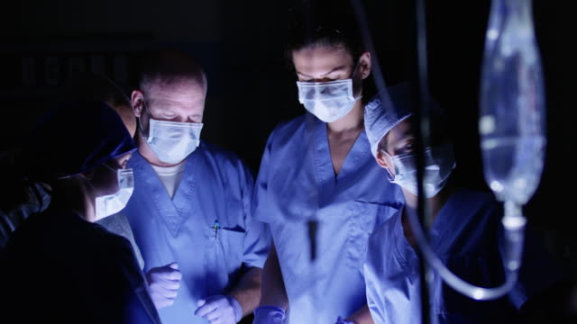 Group of surgeons working in operating room video