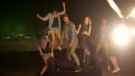 Group of Teenager dancing on a rooftop and have fun video