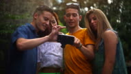 Group of teenager using a smart phone video