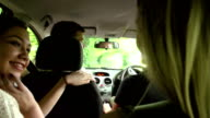 Group Of Teenagers Inside Car Driving Along Road video